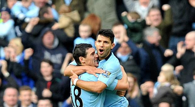 Gareth Barry, pictured left, has fond memories of playing alongside Sergio Aguero