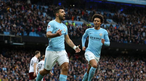 Sergio Aguero, front, is now Manchester City's all-time record scorer