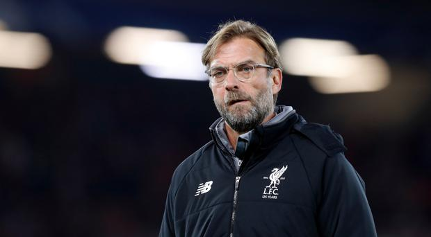 Liverpool manager Jurgen Klopp disagrees with England boss Gareth Southgate's selection criteria.