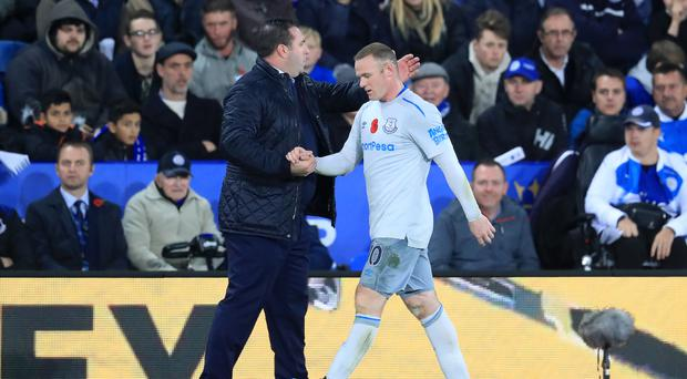 David Unsworth, left, wants senior players like Wayne Rooney, right, to step up against Watford on Sunday