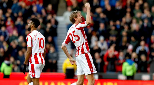 Stoke's Peter Crouch celebrates scoring his side's second goal against Leicester
