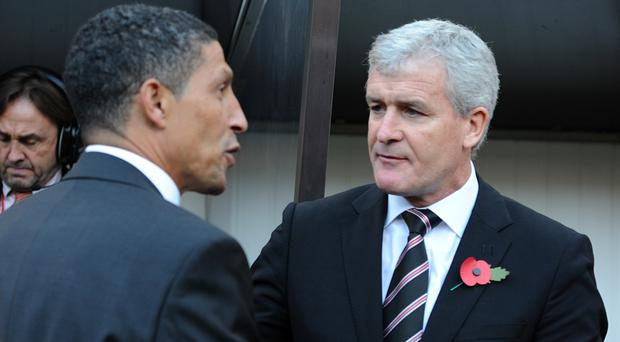 Stoke boss Mark Hughes, right, has been impressed by Chris Hughton's managerial accomplishments