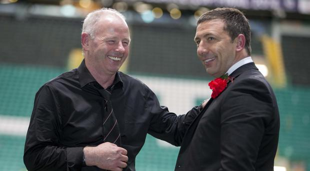 Stewart Milne, left, says Derek McInnes is staying at Pittodrie