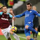 Marko Arnautovic, pictured left, put the hard yards in against Leicester