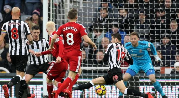 Watford's Will Hughes scores his side's first goal of the game during the Premier League match at St James' Park, Newcastle.