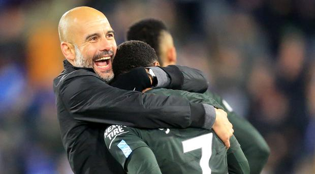 Pep Guardiola, left, was grateful for Raheem Sterling's late winner