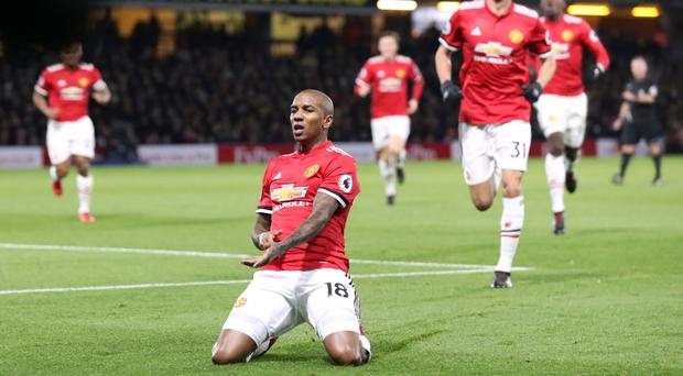 Manchester United's Ashley Young celebrates scoring his side's second goal of the game during the Premier League match at Vicarage Road, Watford.