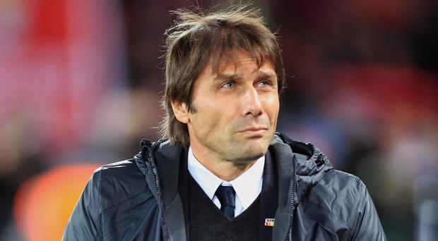 Chelsea head coach Antonio Conte says he will wait to be asked before making suggestions on strengthening his squad in January