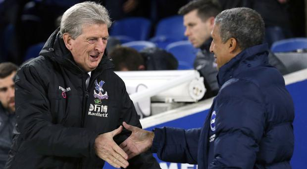 Roy Hodgson, left, and Chris Hughton, right, were left with a point apiece