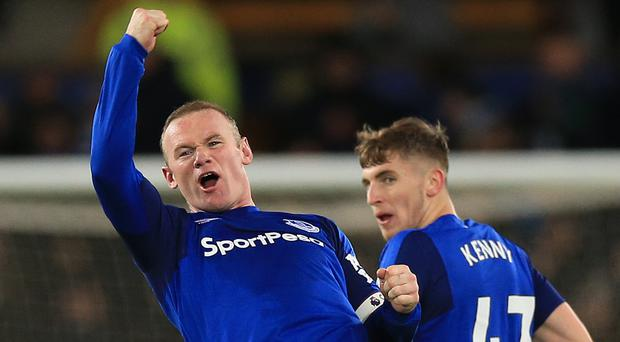 Wayne Rooney celebrates his spectacular third goal