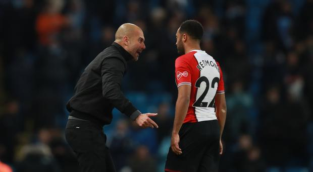 Pep Guardiola, left, had words with Nathan Redmond as the players leave the field