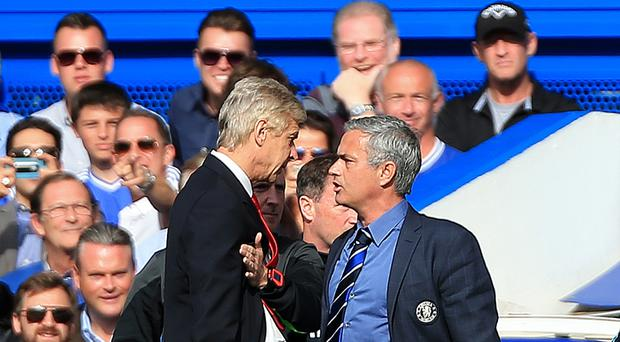 Arsenal manager Arsene Wenger (left) has had a tumultuous relationship with current Manchester United boss Jose Mourinho (right).