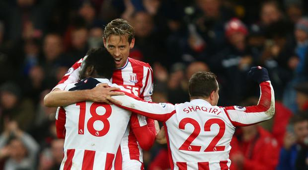 Peter Crouch and Xherdan Shaqiri celebrate Mame Diouf's winning goal against Swansea