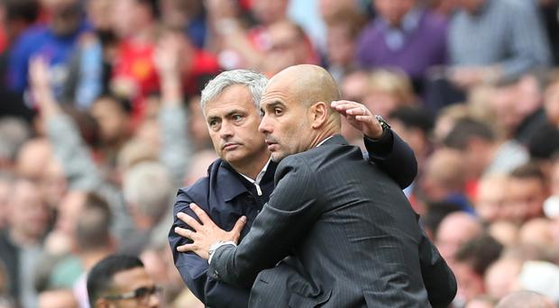Pep Guardiola, right, and Jose Mourinho are old rivals