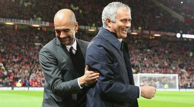 Manchester United manager Jose Mourinho, right, and Manchester City counterpart Pep Guardiola meet on Sunday