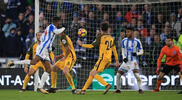 Steve Mounie, left, scores his second