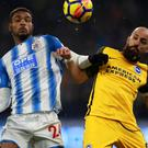 Steve Mounie, left, was twice on target against Brighton