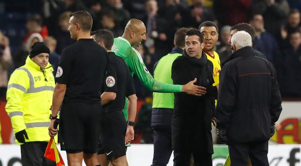 Watford manager Marco Silva (centre, right) speaks with referee Lee Probert