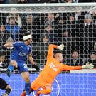 Ayoze Perez (left) scores an own goal to hand Leicester victory