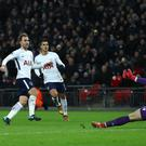 Christian Eriksen (second left) scored Tottenham's fifth goal as they eased past Stoke on Saturday.