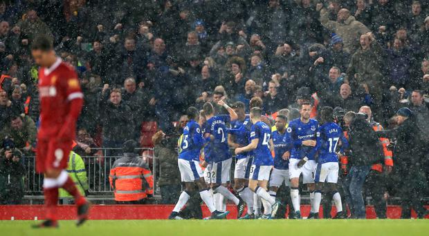 Everton's players celebrate their equaliser