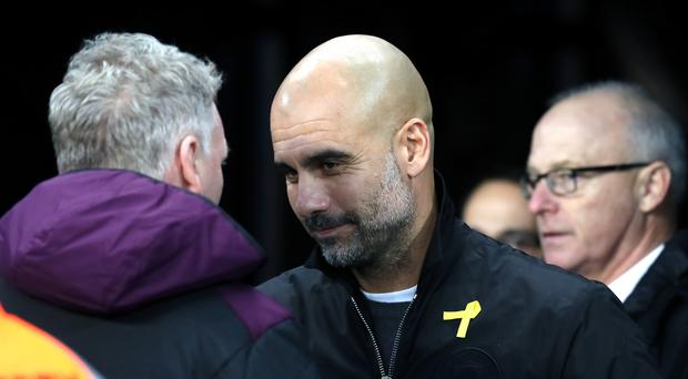 Manchester City manager Pep Guardiola has been wearing a yellow ribbon in support of imprisoned Catalan politicans