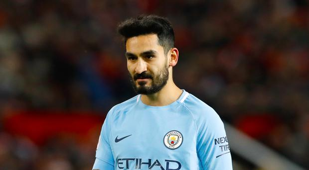 Manchester City's Ilkay Gundogan does not believe the title race is over despite his side's 11-point lead over rivals Manchester United