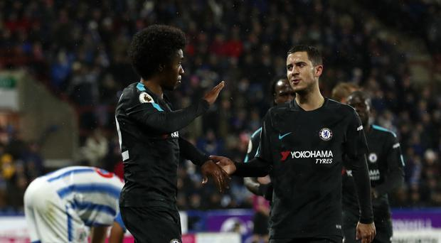 Chelsea's Willian, left, celebrates scoring his side's second goal with teammate Eden Hazard
