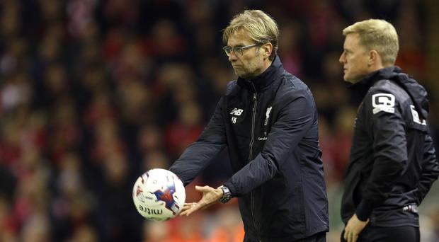 Bournemouth's Eddie Howe, right, believes he and Liverpool boss Jurgen Klopp, left, will remain committed to attack
