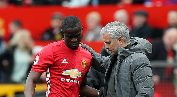 Manchester United's Eric Bailly, pictured left, faces an extended spell on the sidelines