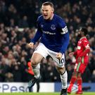 Wayne Rooney scored one penalty and missed another as Everton beat Swansea 3-1