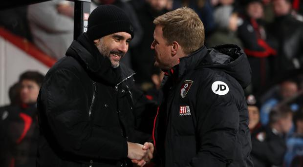 Eddie Howe, right, is preparing to pit his wits against Pep Guardiola
