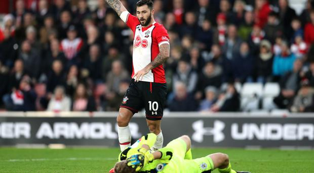 Southampton's Charlie Austin calls for treatment for Huddersfield goalkeeper Jonas Lossl