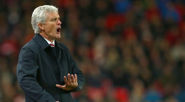 Stoke manager Mark Hughes saw his struggling team achieve a welcome win
