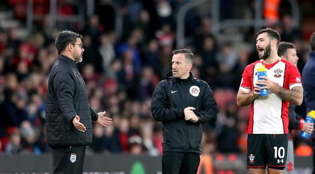 David Wagner, pictured left, was not happy with the actions of Charlie Austin, pictured right