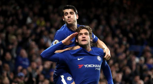 Marcos Alonso, pictured bottom, and Alvaro Morata were on target against Brighton