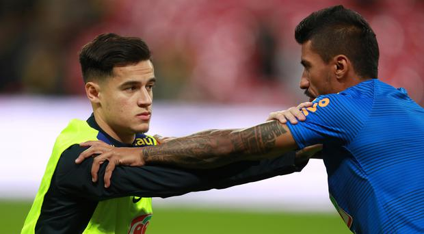 Paulinho, right, is keen for Brazil team-mate Philippe Coutinho to join him at Barcelona