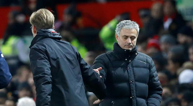 Jose Mourinho, right, was unhappy with Jurgen Klopp's comments about Paul Pogba's transfer fee