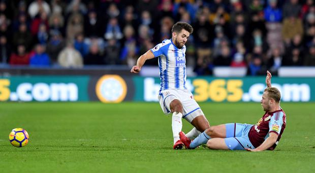 Burnley's Scott Arfield (right) and Huddersfield Town's Tommy Smith (left) collide after a battle for the ball during the Premier League match at John Smith's Stadium, Huddersfield. PRESS ASSOCIATION Photo. Picture date: Saturday December 30, 2017. See PA story SOCCER Huddersfield. Photo credit should read: Anthony Devlin/PA Wire. RESTRICTIONS: EDITORIAL USE ONLY No use with unauthorised audio, video, data, fixture lists, club/league logos or