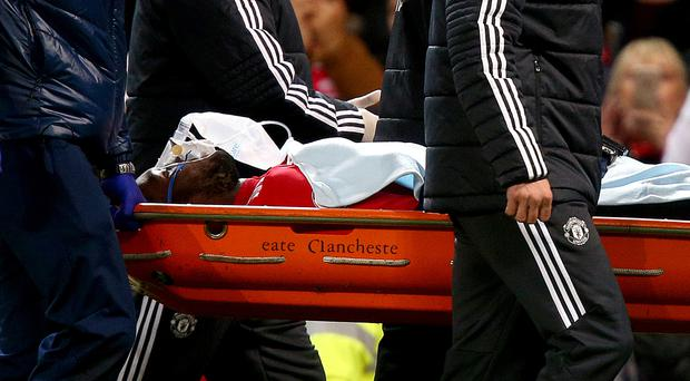 Manchester United's Romelu Lukaku leaves the game on a stretcher