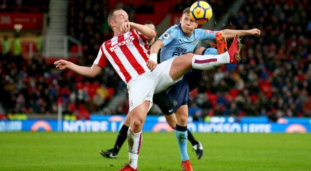 Stoke midfielder Charlie Adam has called on the club to keep faith in manager Mark Hughes
