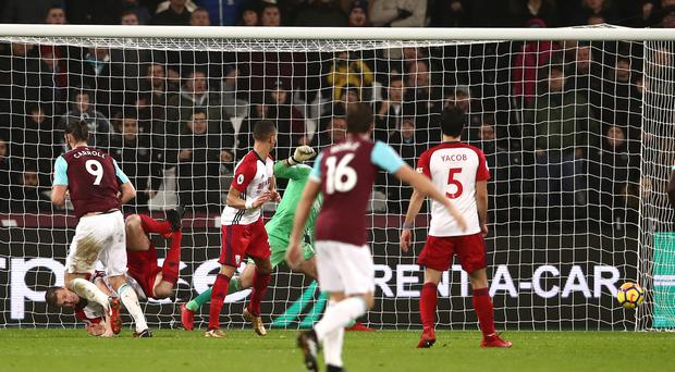 Andy Carroll, left, scored both goals as West Ham fought back to beat West Brom