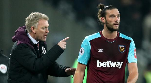 West Ham manager David Moyes, left, was pleased with Andy Carroll's performance