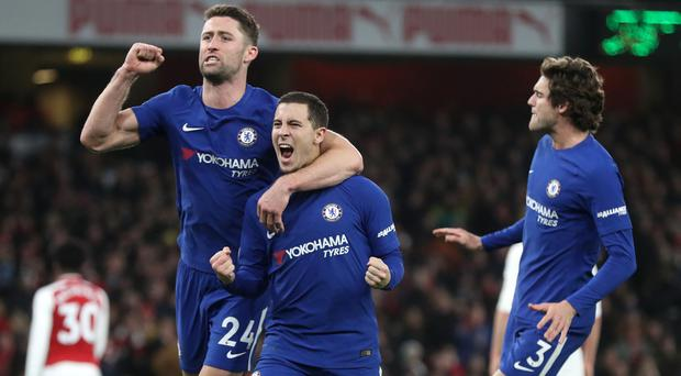 Eden Hazard, centre, celebrates scoring his penalty