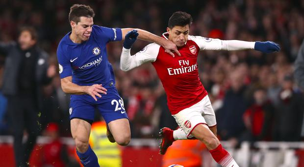 Alexis Sanchez, right, battled throughout as others took the spotlight