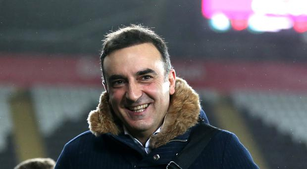 Swansea manager Carlos Carvalhal says he will buying