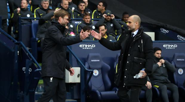 Liverpool manager Jurgen Klopp, pictured left, wants to correct September's anomaly against Manchester City