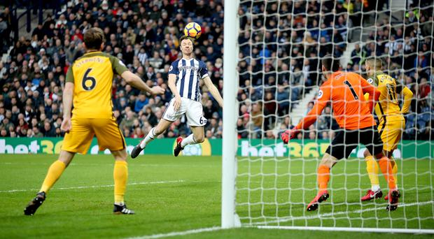 Jonny Evans heads West Brom in front