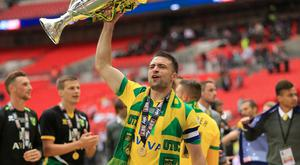 Norwich captain Russell Martin is in Glasgow ahead of a loan move to Rangers.
