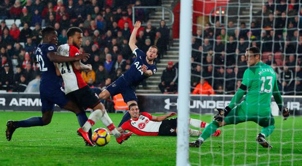 Off target: Spurs' Harry Kane drags an attempt wide of the mark
